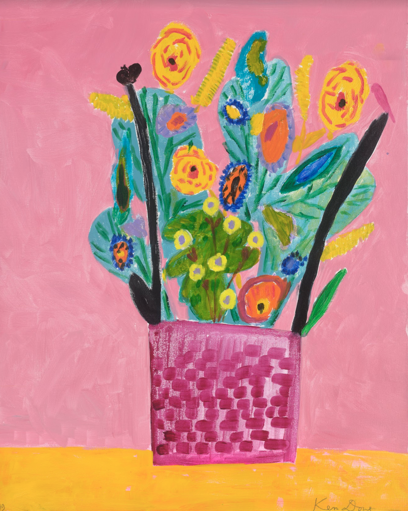 Vase of flowers on a yellow table