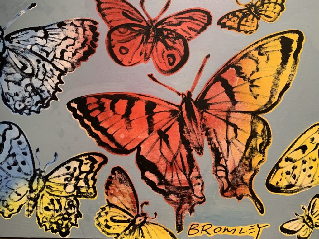 Red and Yellow Butterflies on Dusty Purple