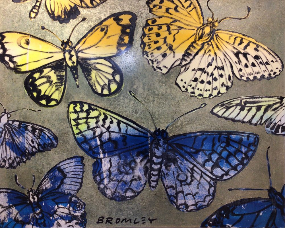 Blue and Yellow Butterflies on Green